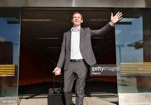 Happy man exits the airport