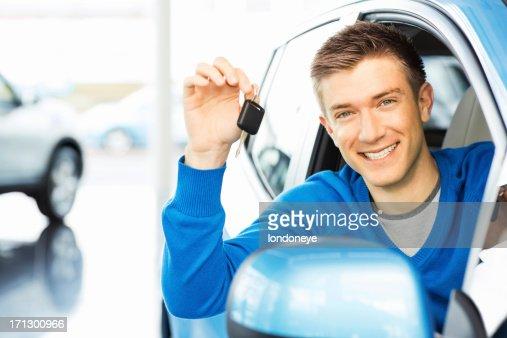 Happy Man Holding Car Key