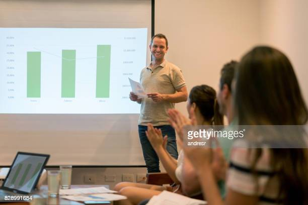 Happy man making a presentation in a business meeting