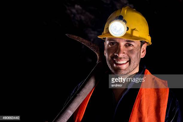 Happy man mining