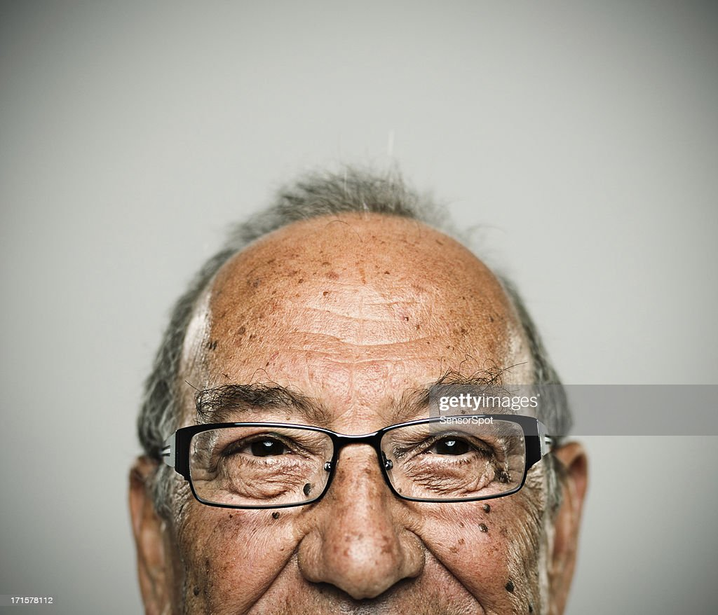 Portrait of a real happy man. Half face