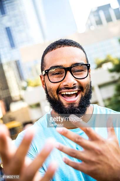 Happy man smiling and laughing at camera