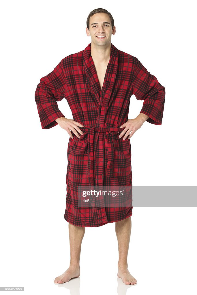 Happy man standing in a bath robe