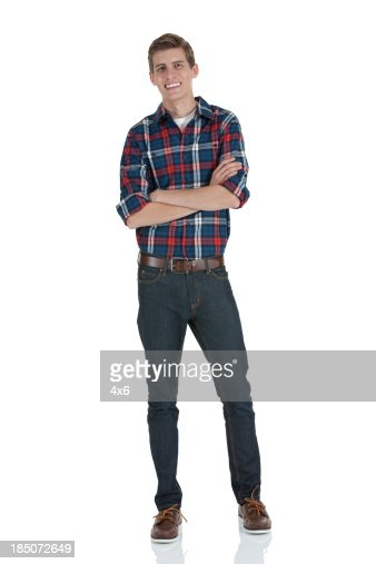 Happy man standing with his arms crossed : Stock Photo
