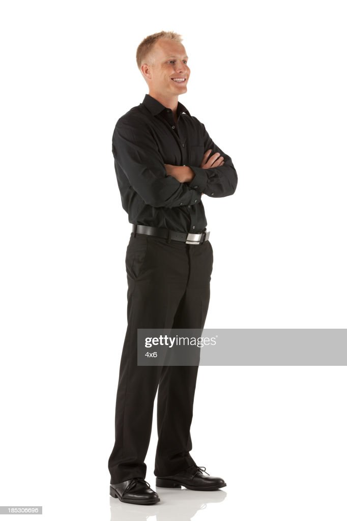 Happy man standing with his arms crossed