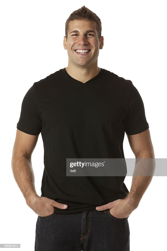 Happy man standing with his hands in pockets : Stock Photo