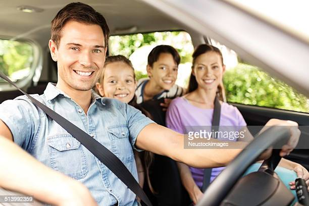 Happy Man Taking Family For Road Trip In Car