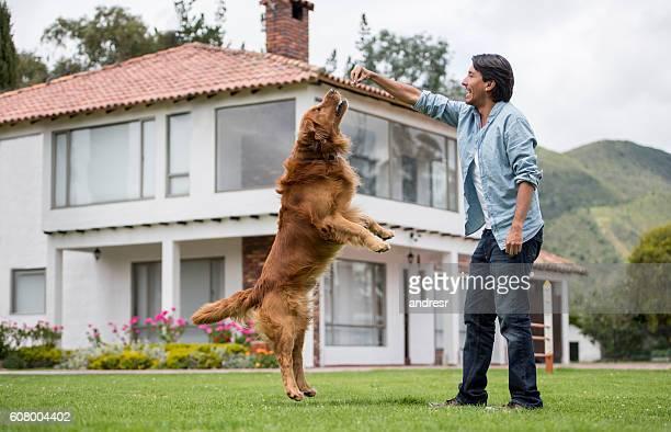 Happy man training his dog