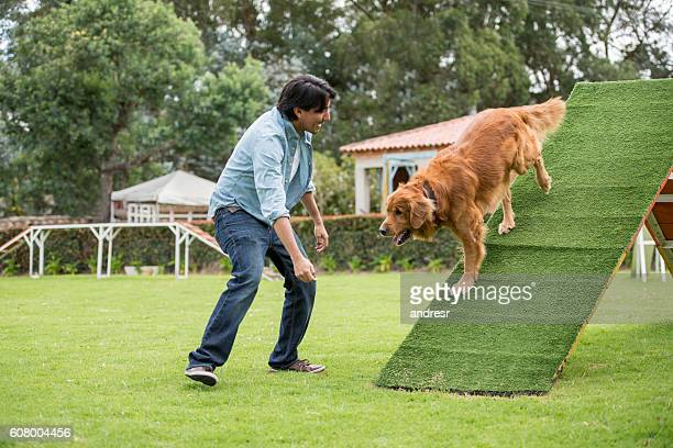 Happy man training his dog