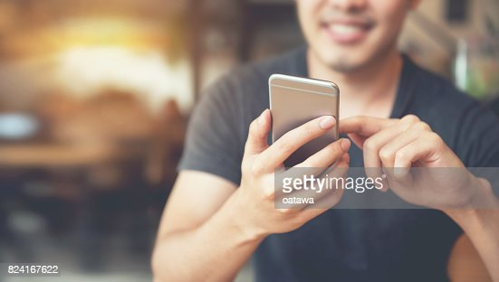 Happy man using smartphone and copy space : Foto de stock