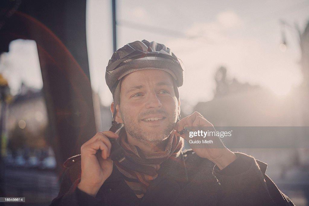 Happy man wearing a cycling helmet