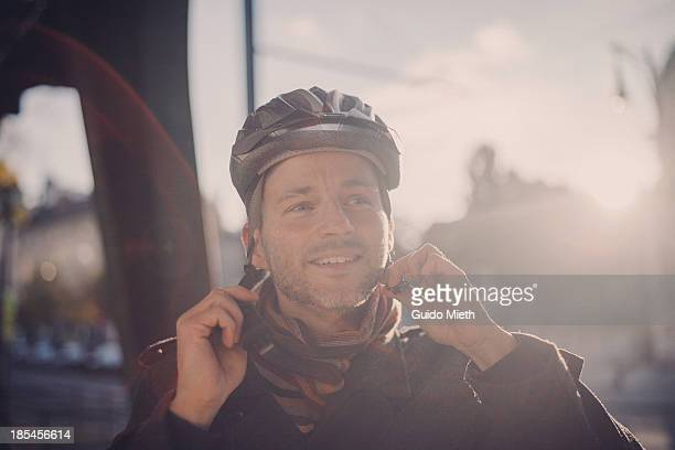 Happy man wearing a cycling helmet
