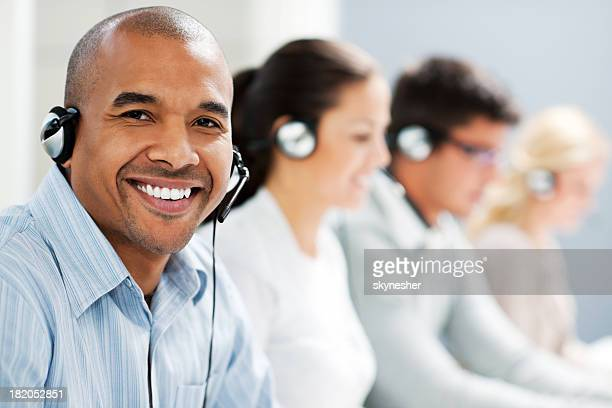 Happy man wearing headset and looking at camera