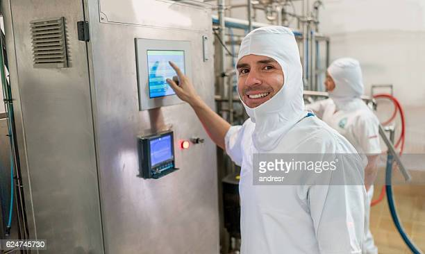 Happy man working at a food factory