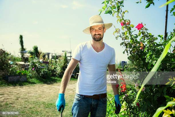 Happy man working in urban garden