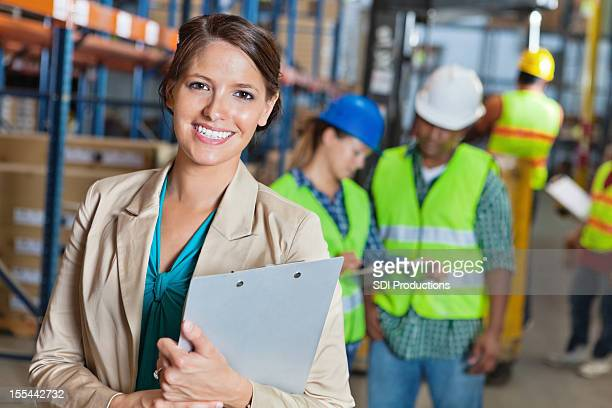 Happy manager in shipping and distribution warehouse facility