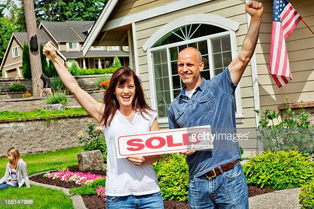 Happy Married Couple with Sold Home