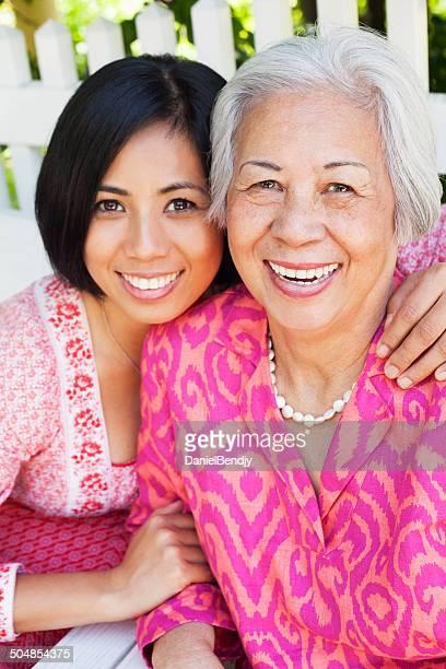 Happy Mature Asian Woman & Daughter