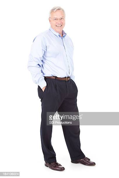 Happy Mature Business Man Standing With Hands in Pockets