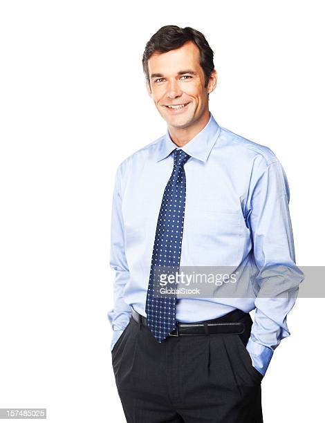 Happy mature businessman with his hands in pockets