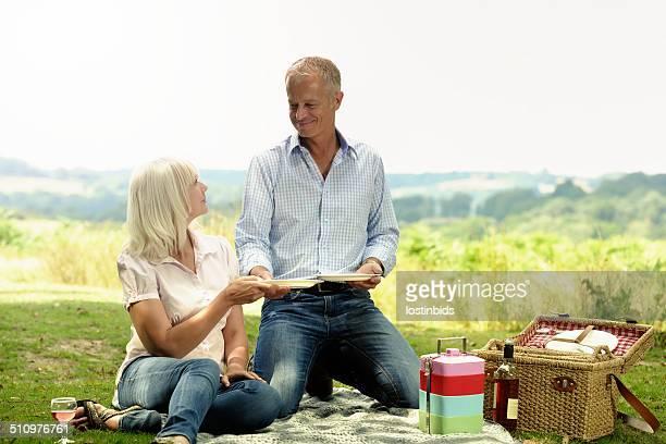 Happy Mature Caucasian Couple Having A Picnic