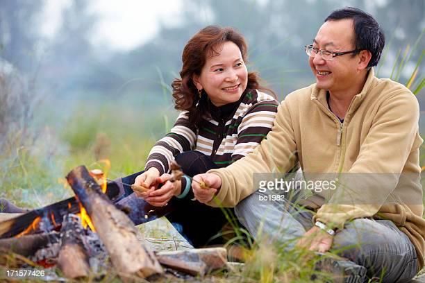 happy mature couple camping