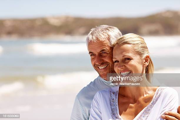 Happy mature couple enjoying at beach