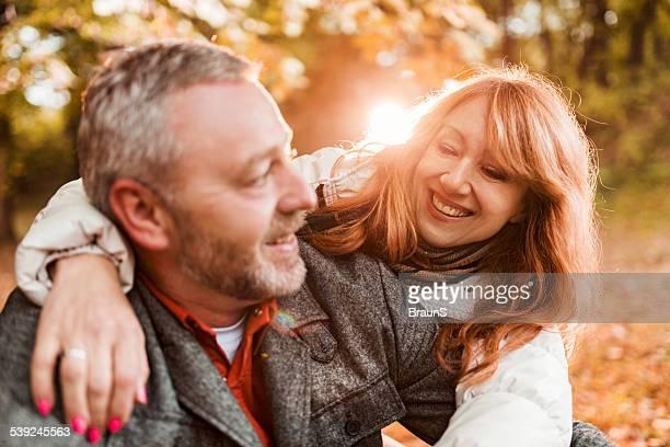 Happy mature couple enjoying in autumn day.