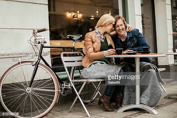 Happy mature couple in cafe