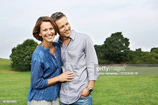 Happy mature couple in park