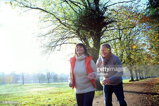 Happy Mature Couple Laughing on an Autumn Day