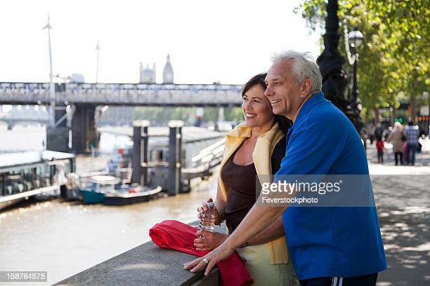 Happy Mature Couple Looking Across The River Thames