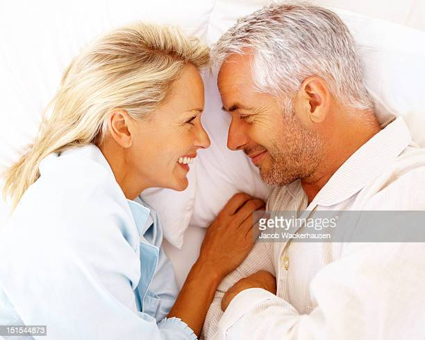 Happy mature couple on bed