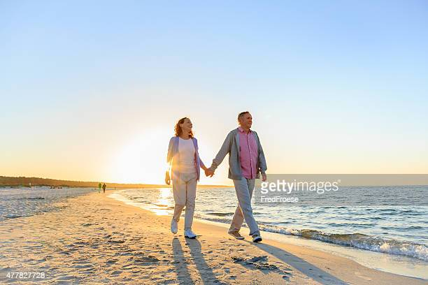 Happy mature couple outdoors on the beach
