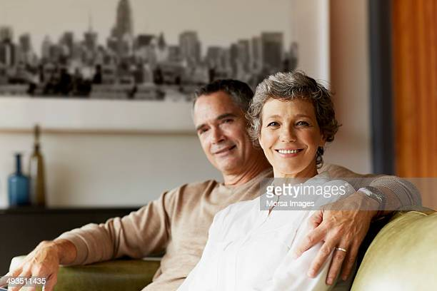 Happy mature couple relaxing at home