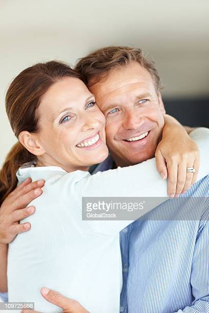 Happy mature couple sharing a passionate hug