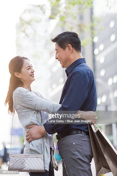 Happy mature couple shopping