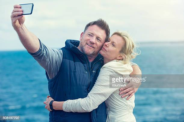 Happy mature couple taking a selfie.