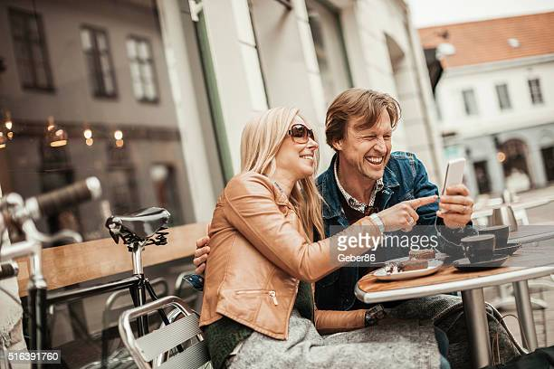 Happy mature couple using mobile phone