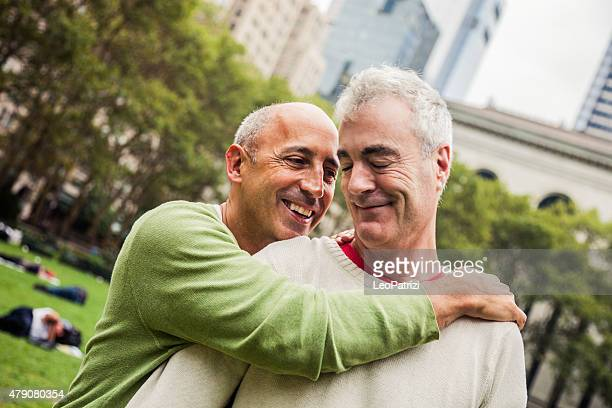 Happy mature gay couple having fun outdoor in the city