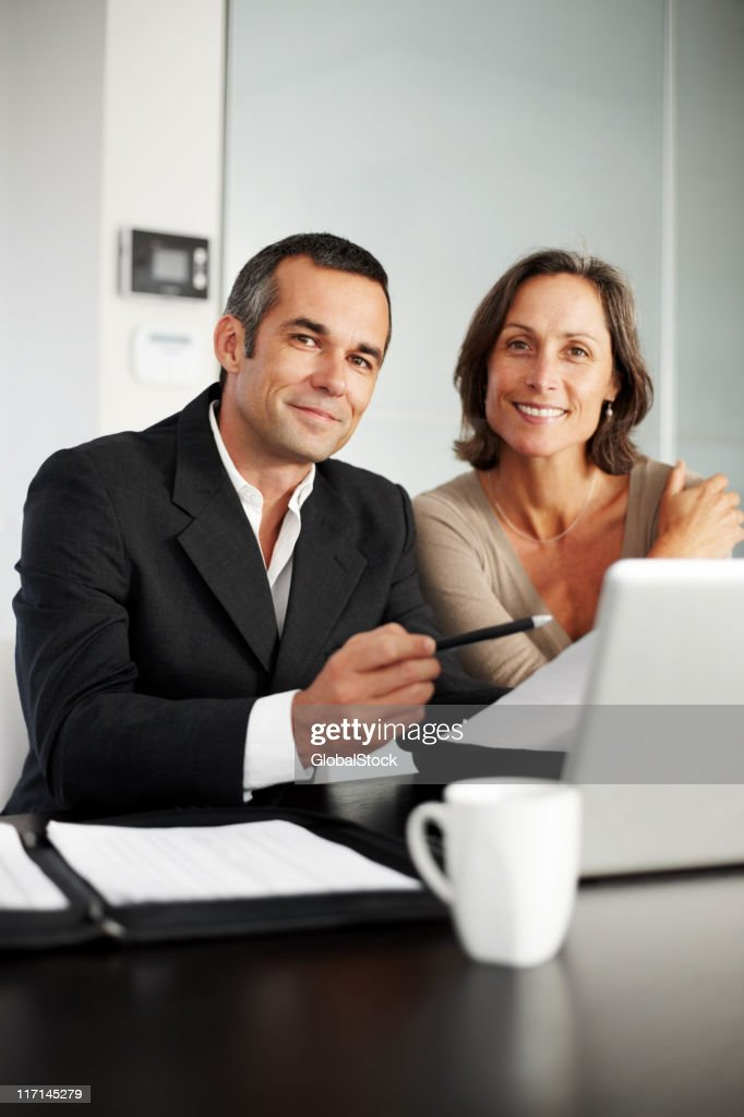 Happy, mature man and woman having a consultation : Stock Photo