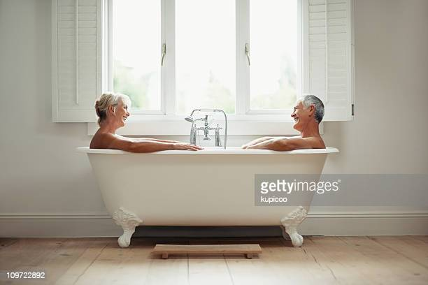 Happy mature man and woman in a bathtub