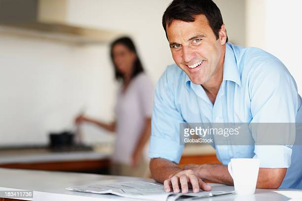 Happy mature man with newspaper