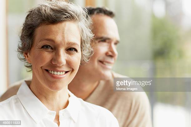 Happy mature woman at home