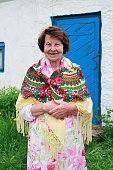 Happy Mature Woman by the Country House. Happy Village Russian Grandmother Concept