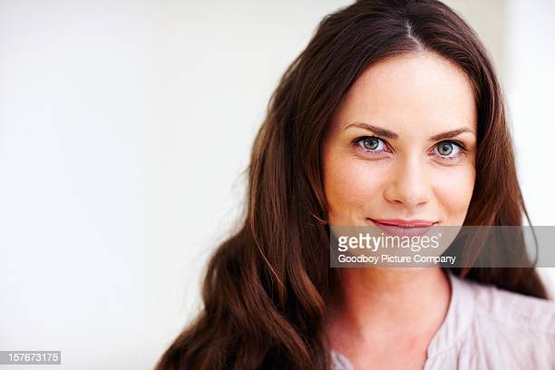 Happy mature woman isolated against white background