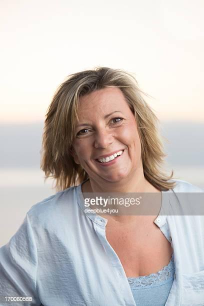 Happy mature woman outdoor portrait