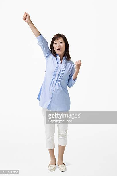 Happy Mature Woman With Hand Raised