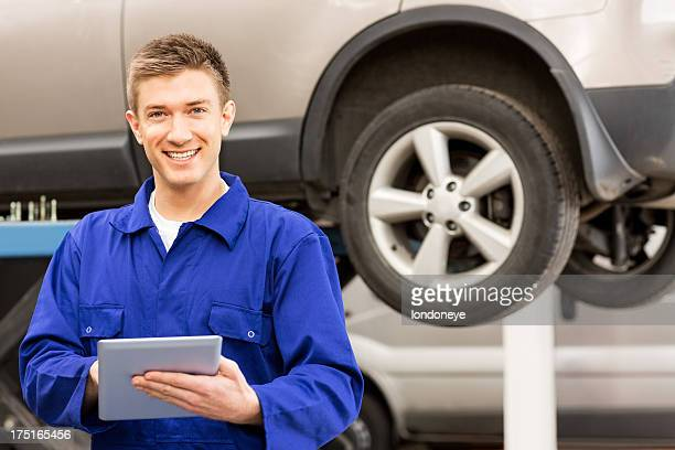 Happy Mechanic Using Digital Tablet