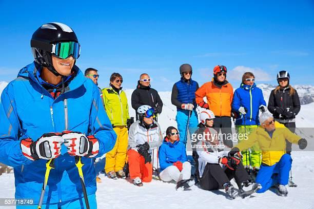 Happy men snow skier enjoying sunbathe on sunny ski resorts